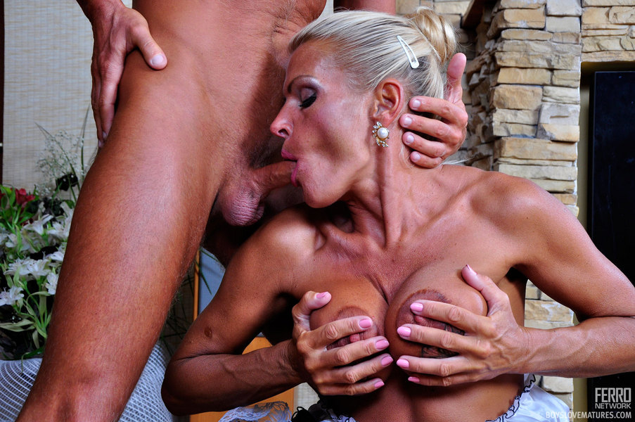 Horny milf enjoying two black coks
