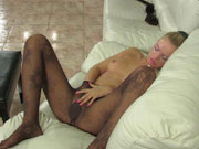 Sexy girl slides her hands under black fashion tights to touch her wet spot