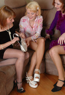 Pantyhose lesbian women having some fun on the couch