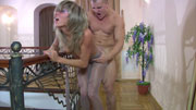 Blond girl clad in shiny grey hose teasing the hell out of a well-hung stud